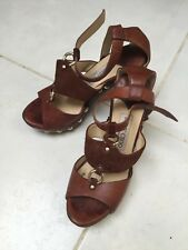 Jimmy Choo womens designer mid heels. Wooden with leather strap.