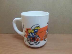 Smurfs – ceramic Mug Belgium (?) c1991 bike bicycle race