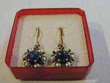 Dorrmeuses oro giallo 18 carati zaffiro cabochon e perle pregiate
