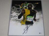 Usain Bolt Jamaica Olympic Gold SignedAutograph 11x14 PHOTO Beckett BAS COA 3