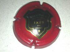 Capsule de champagne BOLLINGER écusson contour or (51. rouge foncé)