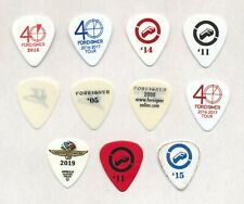 Foreigner Mick Jones set of (11) Guitar Picks  Various Years  Free Shipping