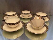 5 tasses à thé avec 5 sous-tasses en porcelaine frise argent style Régence