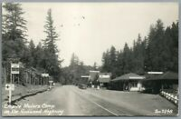 RPPC Postcard Empire Modern Camp on the Redwood Highway Gas Pumps Cars Signs Zan
