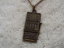 RIVERSIDE RESORT, LAUGHLIN, NEVADA Brasstone Slot Machine Pendant Necklace (A13)