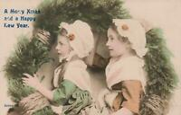 VINTAGE REAL PHOTO of Pretty Young Girls Holding Large Xmas Wreath POSTCARD