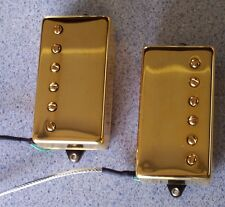 New custom humbucking pickups for electric guitar w/ gold covers by Pete Biltoft