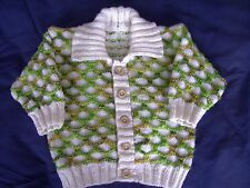 babys hand knitted cardigan in vanilla and caterpillar