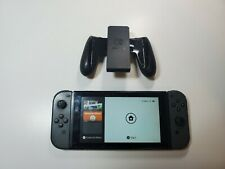 Nintendo Switch Console with Black Joycon Controllers and Gaming Controller