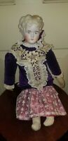 ANTIQUE BISQUE LADY BLONDE SHOULDER HEAD DOLL with old fabric dress
