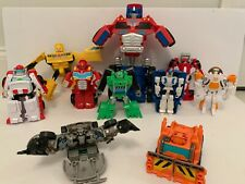 Lot of 10 Transformers Action Figures, Cars, Ambulance, Helicopter, Bulldozer