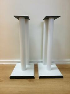 White metal speaker Floor Stands with removable spikes.