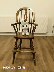 Lovely child's wooden high chair in, I suppose, the style of Captains chair