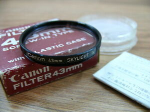 Canon 43mm screw-in , skylight filter with original box.