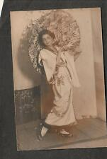 unmailed RPPC photo post card woman with umbrella & dress/Geisha costume?