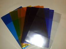 PLASTIC BOOK COVERS SET OF 4 COLOURS.+1 CLEAR  --SMALL TYPE SCHOOL BOOKS