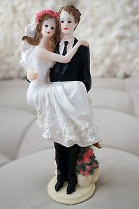Bride and Groom Cake Topper Carry over Threshold Embrace Pink Roses Figurine