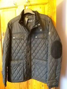 Burton Mens black Quilted Jacket Size Xl inside pocket  lightwieght warm