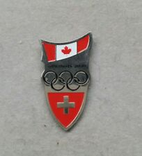 2010 VANCOUVER SWITZERLAND WITH CANADIAN FLAG OLYMPIC WINTER GAMES PIN
