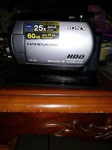 Sony Handycam 60 GB 2000x digital zoom HDD 25x optical zoom Dcr-sr82 w/ station