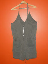 Blank NYC new green, adjustable straps, pockets in front/back romper. Size L