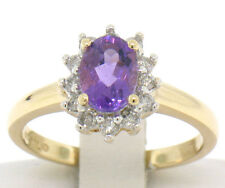 14k Yellow Gold 1.25ctw Oval Amethyst Solitaire & 12 Round Diamond Halo Ring