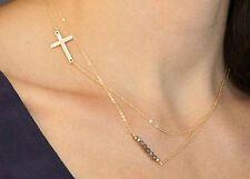 Idée cadeau bijou fantaisie , collier double chaine dorée , croix et perles