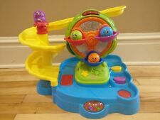 Fisher-Price Topzy Tumblers Twirlin' Tumblin' Fun Park with 4 Beans