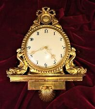 GREAT WALL CLOCK. CARVED WOOD. GOLD LEAF GILDED. FRANCE. CIRCA 1850