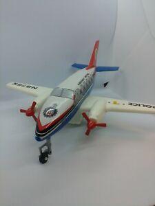 "Beechcraft POLICE PATROL Airplane,""Vintage"" Battery Op. Tin & Plastic, Near Mint"
