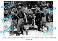 OLD 8x6 PHOTO AUSTRALIAN SOLDIERS CARRYING WOUNDED TARAKAN Is BORNEO c1945
