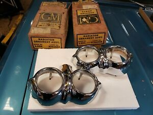 NOS Pair 1958 Chevrolet Parking Light Bezels Impala Bel Air Delray Biscayne