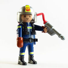 Playmobil Fireman Firefighter Figure with fire extinguisher, helmet and gloves