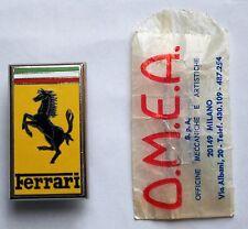 Original Vintage Ferrari OMEA Milano Hood Emblem / Nose Badge and packet