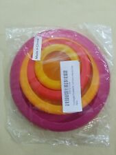 Food Huggers Reusable Silicone Food Savers 4 pcs New in Package Pinks Yellows