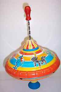 VINTAGE OHIO ART CAROUSEL ANIMALS SPINNING TOP WITH RED WOOD HANDLE--WORKS