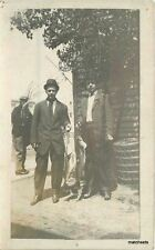C-1910 Two Men & Two Large Fish RPPC real photo postcard 7033