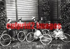 OREGON CORVALLIS Seven young ladies taking rest after bicycle ride REPRODUCTION