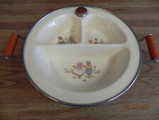 VINTAGE EXCELLO BABY WARMING DISH WITH DUTCH BABIES.HANDLED CHILD DISH WITH PLUG