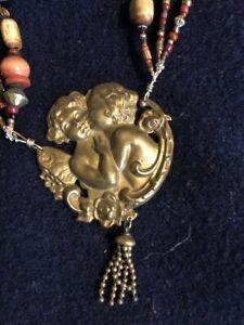 Nance Lopez triple beaded treasure necklace with beautiful cherub center drop