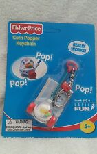 Fisher price corn popper keychain sealed on card from 2000