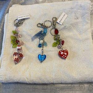 Three long jewel keyrings