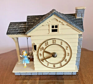 Vintage MASTERCRAFTERS Girl on Swing Cottage Figural Electric Clock.  Nds Repair