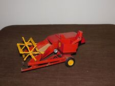 """VINTAGE TOY 11"""" LONG REUHL PRODUCTS  MASSEY HARRIS RED METAL CLIPPER COMBINE"""