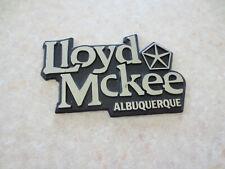 Lloyd McKee Chrysler Albuquerque New Mexico dealership car badge / emblem -