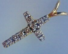 Cruz de oro 18 cts y diamantes
