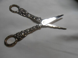 ANTIQUE STERLING SILVER GRAPE SHEARS BY WM. DEMATTEO- FACES ON HANDLE 120 GRMS.S
