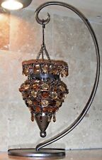 Candle Holder Metal Base Curves Upwards Suspended from it is a Jeweled Cone New