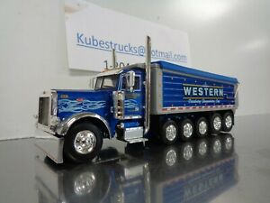 1/64 DCP 34062  Western Distributing 379 Peterbilt Day Cab 5 AXLE DUMP (NEW)