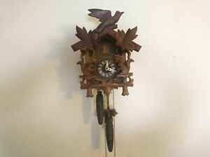 VINTAGE BLACK  FOREST CUCKOO CLOCK IN PERFECT WORKING ORDER AND VERY ACCURATE